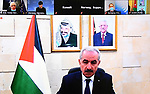 Palestinian Prime Minister Mohammad Ishtayeh, speaks during the AHLC donor nations meeting, in the West Bank city of Ramallah, on February 23, 2021. Photo by Prime Minister Office