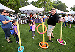 Andrea Onesto, 5, center, plays a game with Carson City Juvenile Detention Supervisor Frank Mournighan at the 16th annual National Night Out event, hosted by the Carson City Sheriff's Office, in Carson City, Nev., on Tuesday, Aug. 7, 2018.<br /> Photo by Cathleen Allison/Nevada Momentum