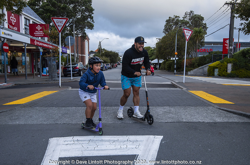 Evan Belford takes his son Liam out scootering. Khandallah shopping centre at 4.30pm, Wednesday, during lockdown for the COVID19 pandemic in Wellington, New Zealand on Wednesday, 22 April 2020. Photo: Dave Lintott / lintottphoto.co.nz