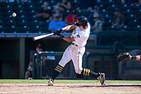 Surprise Saguaros shortstop Cole Tucker (2), of the Pittsburgh Pirates organization, puts a ball in play during an Arizona Fall League game against the Salt River Rafters on October 9, 2018 at Surprise Stadium in Surprise, Arizona. Salt River defeated Surprise 10-8. (Zachary Lucy/Four Seam Images)