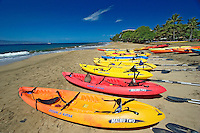 Kayaks on Kaanapali Beach and the island of Lanai from Maui, Hawaii.