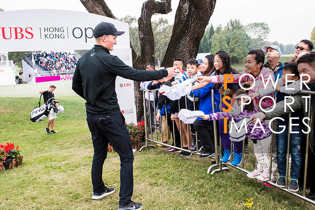 Marcus Kinhult of Sweden interacts with the little fans during the day three of UBS Hong Kong Open 2017 at the Hong Kong Golf Club on 25 November 2017, in Hong Kong, Hong Kong. Photo by Marcio Rodrigo Machado / Power Sport Images
