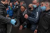 Obdachlose bekommen Kleidung und Matten am Bahnhof in Kiew von Mitarbeitern von Sant'Egidio. / Homeless people receive clothes and mats at the station in Kiev from Sant'Egidio staff.<br /><br />Obdachlose in Kiew während der Corona Krise. Es gibt nach inofiziellen Schätzungen bis zu 20000 Obdachlose in der ukrainischen Hauptstadt. Viel stattliche Hilfe gibt es nicht, aber kleine Organisationen versuchen das nötigste zu organisieren. / Homeless in Kiev during the Corona crisis. According to unofficial estimates, there are up to 20000 homeless people in the Ukrainian capital. There is not much help, but small organizations try to organize the most necessary.