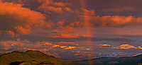 902300001 panoramic view - a rainbow forms over mount denali and the alaska range during a clearing storm in denali national park alaska