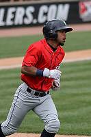 Cedar Rapids Kernels designated hitter Jeferson Morales (13) runs to first base during a game against the Wisconsin Timber Rattlers on September 8, 2021 at Neuroscience Group Field at Fox Cities Stadium in Grand Chute, Wisconsin.  (Brad Krause/Four Seam Images)