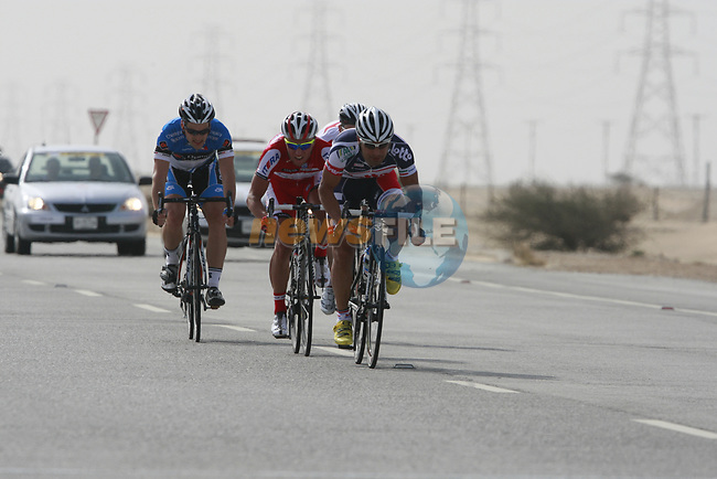 The breakaway Mehdi Sohrabi (IRI) Lotto-Belisol Team leads Mikhail Ignatyev (RUS) Katusha Team and Alexandre Lemair (FRA) over the line at the 1st bonus sprint point near Umm Al Qahab during Stage 3 of the 2012 Tour of Qatar running 146.5km from Dukhan Souq, Dukhan to Al Gharafa, Qatar. 7th February 2012.<br /> (Photo Eoin Clarke/Newsfile)
