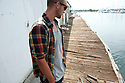 Jason Finlay at an old dock in Waikiki on Oahu in Hawaii