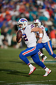 Buffalo Bills quarterback Nathan Peterman (2) scrambles during an NFL Wild-Card football game against the Jacksonville Jaguars, Sunday, January 7, 2018, in Jacksonville, Fla.  (Mike Janes Photography)