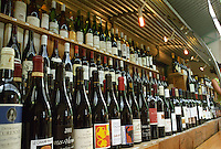 Wine shop at the market Marche des Enfants Rouge in Marais. Paris, France.