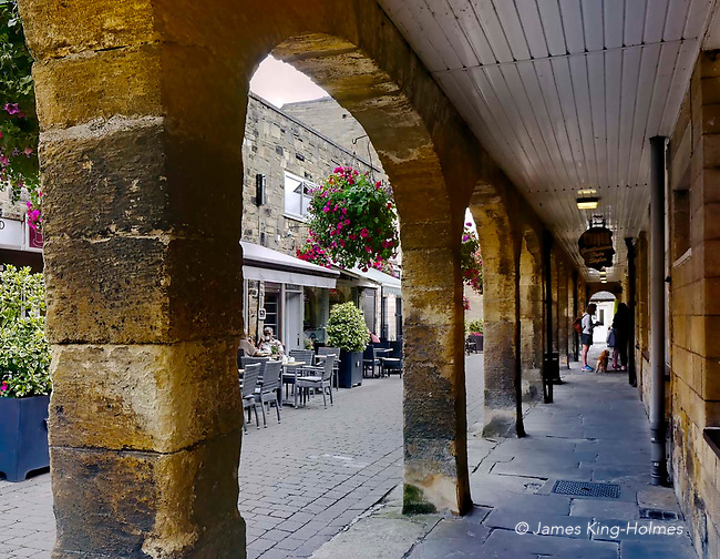 The arched walkway of The Shambles in Wetherby, West Yorkshire. The building was erected in 1811 by the then Duke of Devonshire to accommodate butchers' shops, rented out for three guineas (three pounds & three shillings) per year. The street was later used in the 19th Century as an open market for local farmers to sell their dairy produce and has now been developed and renovated as part of the pedestrian area within the town centre.