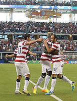 Eddie Johnson #26 of the USMNT congratulates Landon Donovan #10 for scoring a goal from an assist by Alejandro Bedoya #20 against Honduras on July 24, 2013 at Dallas Cowboys Stadium in Arlington, TX. USMNT won 3-1.