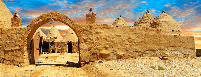 """Pictures of the beehive adobe buildings of Harran, south west Anatolia, Turkey.  Harran was a major ancient city in Upper Mesopotamia whose site is near the modern village of Altınbaşak, Turkey, 24 miles (44 kilometers) southeast of Şanlıurfa. The location is in a district of Şanlıurfa Province that is also named """"Harran"""". Harran is famous for its traditional 'beehive' adobe houses, constructed entirely without wood. The design of these makes them cool inside. 40"""