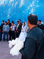 Couple of Uzbeks getting photographed in the garden surrounding Ulugh Beg observatory, Samarkand
