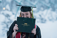 Ashley Roylance, B.B.A. Management, celebrates outside the Alaska Airlines Center after UAA's Fall 2018 Commencement Ceremony.