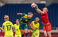TOKYO, JAPAN - JULY 24: Alanna Kennedy #14 of Australia goes up for a header as Hedvig Lindahl #1 of Sweden punches the ball during a game between Australia and Sweden at Saitama Stadium on July 24, 2021 in Tokyo, Japan.
