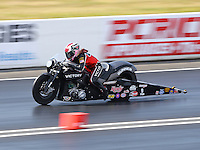 Jun 6, 2015; Englishtown, NJ, USA; NHRA pro stock motorcycle rider Angie Smith during qualifying for the Summernationals at Old Bridge Township Raceway Park. Mandatory Credit: Mark J. Rebilas-