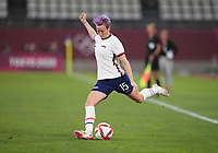 KASHIMA, JAPAN - AUGUST 2: Megan Rapinoe #15 of the United States kicks the ball during a game between Canada and USWNT at Kashima Soccer Stadium on August 2, 2021 in Kashima, Japan.