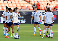 HOUSTON, TX - JUNE 10: Kristie Mewis #22 of the United States warming up with her teammates before a game between Portugal and USWNT at BBVA Stadium on June 10, 2021 in Houston, Texas.