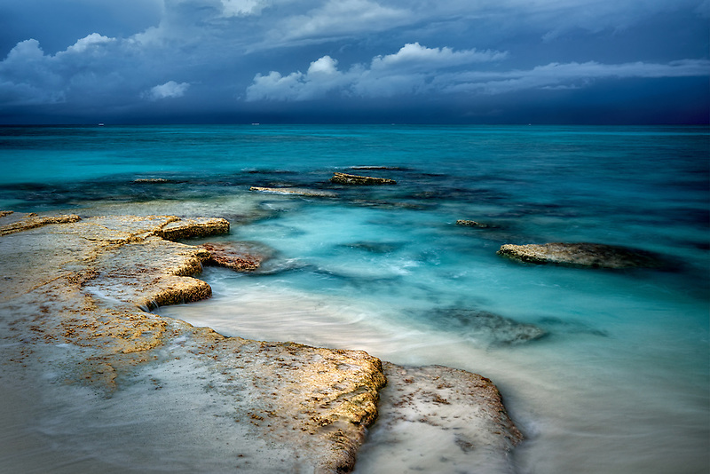 Shore and storm clouds over ocean at Turks and Caicos.