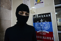A hooded activists inside the polling station on the day before the popular referendum called to separate the Eastern region from Ukraine. Donetsk, Ukraine