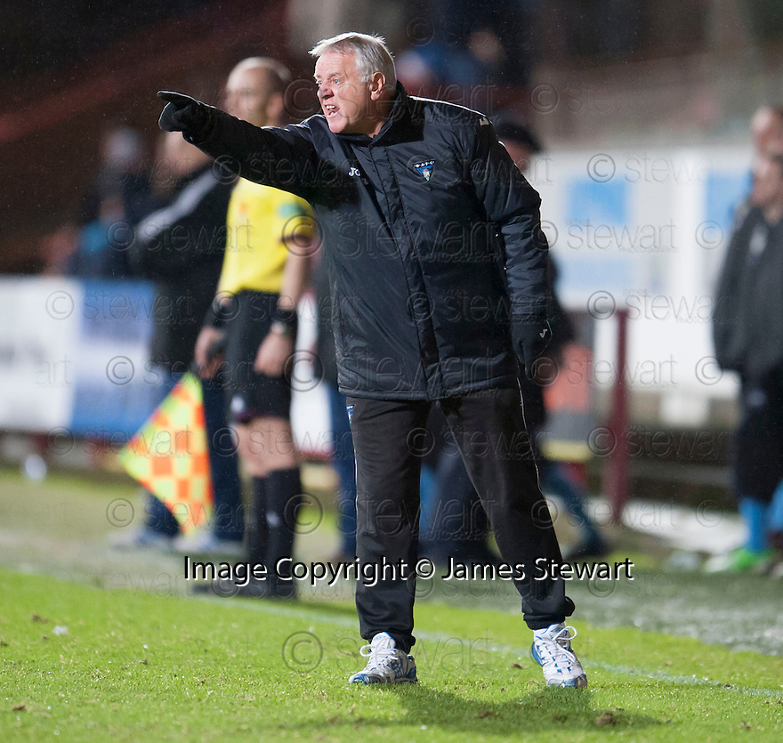 Dunfermline manager Jim Jeffries enters the field of play to get his instructions over.