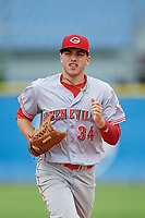 Greeneville Reds center fielder Mike Siani (34) jogs back to the dugout during the first game of a doubleheader against the Princeton Rays on July 25, 2018 at Hunnicutt Field in Princeton, West Virginia.  Princeton defeated Greeneville 6-4.  (Mike Janes/Four Seam Images)