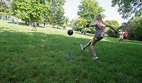 Children play kickball Wednesday July 14, 2021 in a grassy area next to the Yvonne Richardson Center in Fayetteville. The city has a plan to expand the center with a teaching kitchen and multipurpose space and other features at the request of residents and as the budget allows. The parks bond issue voters approved in April 2019 included $1 million for the center's expansion. Visit nwaonline.com/21000719Daily/ and nwadg.com/photo. (NWA Democrat-Gazette/J.T. Wampler)