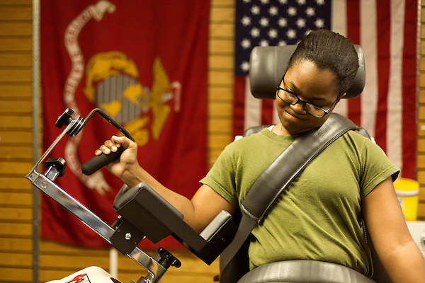 October 21, 2014. Camp LeJeune, North Carolina.<br />  LCpl. Jada Connor, age 19, who is one of the female volunteers for the Ground Combat Element Integrated Task Force, has her upper body strength tested by the University of Pittsburgh. UPITT is in charge of the medical testing section of the GCEITF.<br />  The Ground Combat Element Integrated Task Force is a battalion level unit created in an effort to assess Marines in a series of physical and medical tests to establish baseline standards as the Corps analyze the best way to possibly integrate female Marines into combat arms occupational specialities, such as infantry personnel, for which they were previously not eligible. The unit will be comprised of approx. 650 Marines in total, with about 400 of those being volunteers, both male and female. <br />  Jeremy M. Lange for the Wall Street Journal<br /> COED