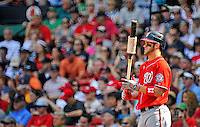 10 June 2012: Washington Nationals outfielder Bryce Harper stands on deck during a game against the Boston Red Sox at Fenway Park in Boston, MA. Harper scored the game winning run in the 9th inning as the Nationals defeated the Red Sox 4-3 to sweep their 3-game interleague series. Mandatory Credit: Ed Wolfstein Photo