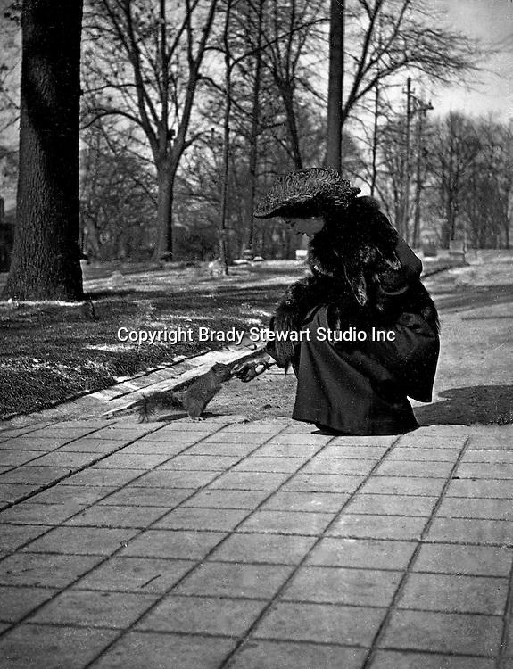 Washington DC:  Sarah Stewart feeding a squirrel in Folger Park. Brady and Sarah Stewart stayed at a nearby hotel while on their honeymoon