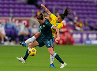 ORLANDO, FL - FEBRUARY 18: Aldana Cornetti #6 of Argentina fights for the ball with Debinha #9 of Brazil during a game between Argentina and Brazil at Exploria Stadium on February 18, 2021 in Orlando, Florida.