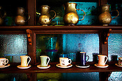 Different shapes and sizes of jugs and coffee cups are displayed at the Adriatico Cafe in Manila, Philippines. Photo: Sanjit Das