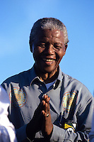 Nelson Mandela speaks to supporters at a campaign event.   After more then 27 years in jail as an anti-apartheid activist,   Nelson Mandela lead a 1994 campaign for President as a member of the African National Congress (ANC),  in the first free elections in South Africa in 1994.  Mandela has received more than 250 awards over four decades, including the 1993 Nobel Peace Prize.