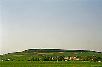 The Corton hill seen over the village Aloxe-Corton. Le Charlemagne vineyard to the left Le Corton to the right. Bourgogne