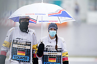 8th October 2020, Nuerburgring, Nuerburg, Germany; FIA Formula 1 Eifel Grand Prix Free Practise is cancelled due to heavy fog and lack of medical security services; A marshal with umbrella