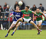 Barry Duggan of  Cratloe in action against Michael O Dwyer of Kilmurry Ibrickane during their senior football final replay at Cusack park. Photograph by John Kelly.