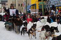2010 Iditarod Ceremonial Start in Anchorage Alaska musher # 25 RYAN REDINGTON with Iditarider GEORGEANNE EISKAMP
