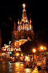 Night time lights on at the plaza and the Parroquia Church of St. Michael Archangel, San Miguel De Allende, a World Heritage Site, Central Mexico