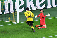 14th April 2021; Induna Park, Dortmund, Germany; UEFA Champions League Football quarter-final, Borussia Dortmund versus Manchester City; Jude Bellingham  Dortmund clears the ball from his 6-yard box after it hit the bar watched by keeper Marvin Hitz  Dortmund