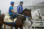 Preakness contender Astrology leaves the track after a gallop on Thursday morning, accompanied by assistant trainer Scott Blasi on stable pony Pancho. May 19, 2011, at Pimlico Race Course in Baltimore, MD. (Joan Fairman Kanes/EclipseSportswire)