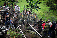 "At least 11 people were killed when a cargo train nicknamed ""La Bestia,"" or ""The Beast,"" on which would-be migrants hitch rides toward the U.S. border, derailed in a remote area of southern Mexico on Sunday August 26th 2013. Every year, thousands of undocumented migrants cling to the wagons of ""the Beast"", a freight train that runs from southern Mexico to the US-Mexican border, braving bandits, immigration officials and the elements to reach ""El Norte""."
