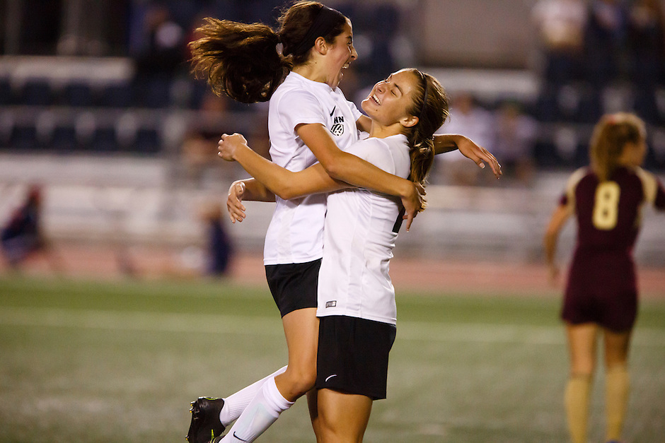 Penn's Maya Lacognato, left, and Kristina Lynch celebrate a goal against Brebeuf Jesuit during the IHSAA Class 2A Girls Soccer State Championship Game on Saturday, Oct. 29, 2016, at Carroll Stadium in Indianapolis. Special to the Tribune/JAMES BROSHER