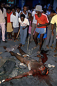 Port-au-Prince, Haiti<br /> November 1987<br /> <br /> Haitians celebrate the public dismembering of a suspected ton-ton-macoute prior to the elections to be held on November 29th, the first attempt at a democratic election in Haiti. It was unsuccessful as 34 people were killed at a polling station and elections were moved up to February 1988.<br /> <br /> Leslie François Manigat won the election with many political parties boycotting. He had military backing but once in office he sought greater control over the military in an effort, to fight corruption. Manigat's government was overthrown by General Henri Namphy within months.
