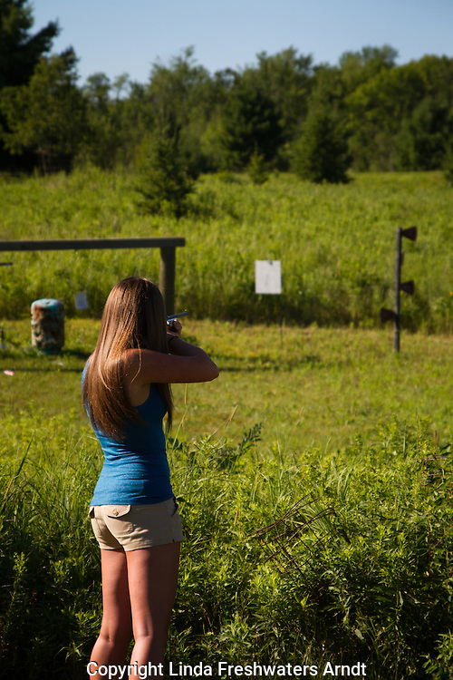 Young woman shooting at targets