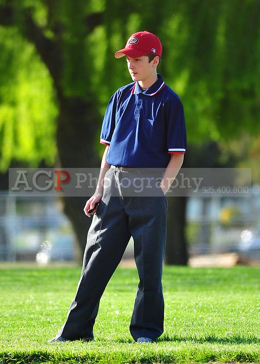 Pleasanton National Little League umpires work a game  at the Pleasanton Sports Park Thursday March 18, 2010. (Photo by Alan Greth)