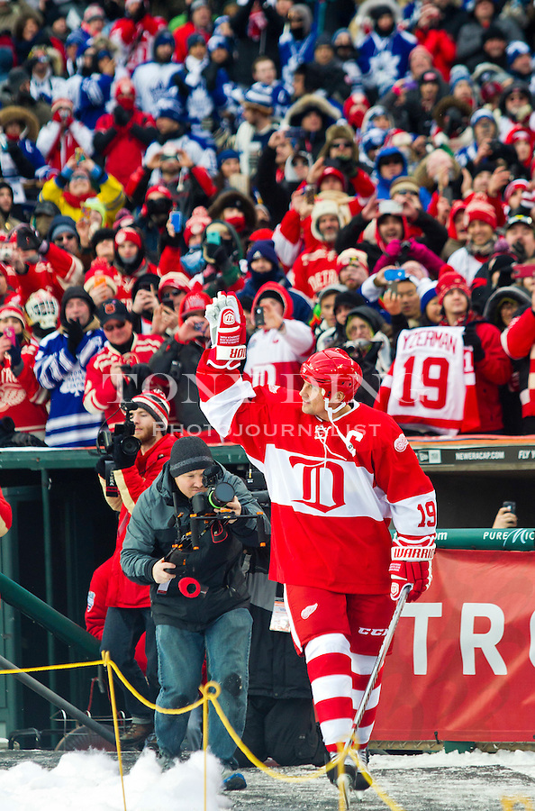 31 December 2013: Former Detroit Red Wings forward Steve Yzerman (19) waves to acknowledge fans as he is introduced before the Toronto Maple Leafs v Detroit Red Wings Alumni Showdown hockey game, at Comerica Park, in Detroit, MI.