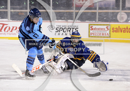 St. Michaels Buzzers forward Jake Evans (17) scores a goal on Buffalo Junior Sabres goalie Joseph Pianta (29) during the Frozen Frontier outdoor game at Frontier Field on December 15, 2013 in Rochester, New York.  St. Michael's defeated Buffalo 5-4.  (Copyright Mike Janes Photography)
