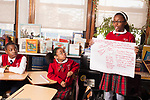 Education elementary Grade 5 female student presenting her group's report to class history/social studies topic