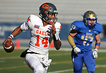 Bishop Gorman's quarterback Dorian Thompson-Robinson scrambles under pressure from Reed during the first half of the NIAA 4A state championship football game in Reno, Nev., on Saturday, Dec. 2, 2017. Cathleen Allison/Las Vegas Review Journal @NVMomentum