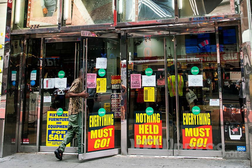 NEW YORK, NY - AUGUST 8: A man enters a retail store closing in Times Square on August 8, 2020 in New York City. With more than four months NYC has closed some of their doors to combat the coronavirus, putting its vital tourism industry paralyzed with a moribund economy, where business and leaders are trying to revive an industry that brought in $45 billion annually and supported more than 300,000 jobs. (Photo by Eduardo MunozAlvarez/VIEWpress)